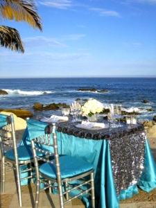 Silver and tiffany blue tablecloth and chair-covers from the Linens, Things and more... 2010 collection in Los Cabos