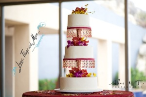 Sunset wedding cake table Cabo