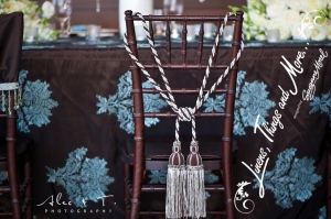 Brown and blue Chevarri chair and Tassel Cabo Wedding