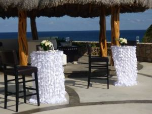 White linens and seashells wedding decor Catillo Escondido Los Cabos
