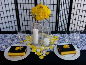 Black and yellow wedding set-up Cabo