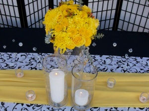 high end yellow floral arrangement with crystals and butterflies Cabo Design