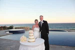 Beige wedding cake table on the beach Los Cabos