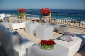 Beach side lounge with silver rentals and cushions at the Hilton Los Cabos