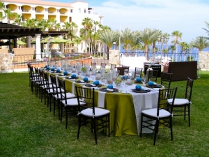 green and off white linens set-up for wedding at the Hilton Los Cabos