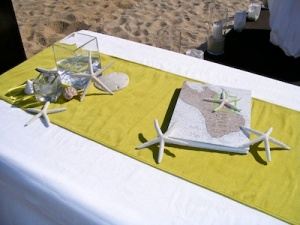 Off white and green guest table at the Hilton Los Cabos