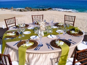 green and sand wedding set-up on the beach at the Hilton Cabo