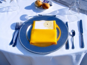 yellow napkin and silver charger for wedding at Dreams Los Cabo
