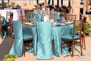 turquoise blue tablecloths and chair jacket Los Cabos