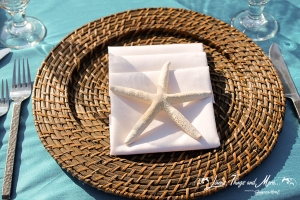 Napkin and starfish on wicker charger Cabo