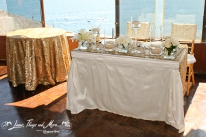Los Cabos wedding set-up: Gold cake table and sweetheart table