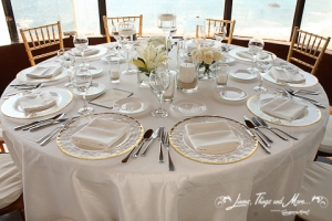 Los Cabos wedding set-up: Gold and off white tables