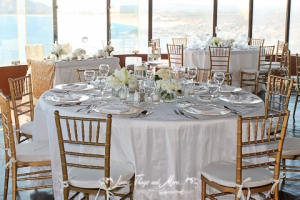 Los Cabos wedding decor: Gold and off white tables and chivari chairs