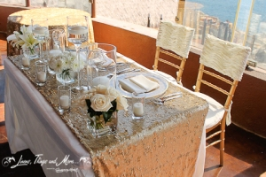 Los Cabos wedding decor: Gold and off white linens