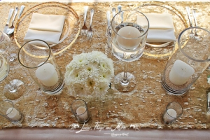 Los Cabos wedding decor: Gold runner and off white linens
