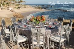 Silver tablecloth and chair bands wedding Cabo San Lucas Resort Esperanza