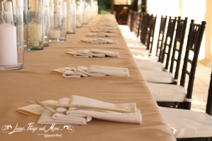 Off white napkins on sand linen for rehearsal dinner
