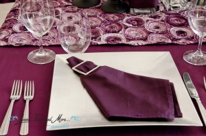 High end event decor purple napkins and runner Cabo