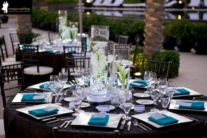Guest table decor at Cabo Azul wedding Turquoise and brown