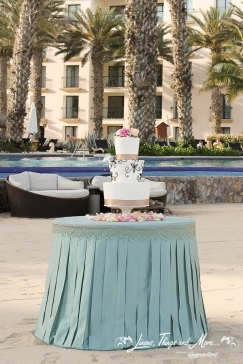 Aqua, Champagne wedding cake table at Barcelo Los Cabos