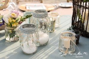 Mason jars wedding decor on the beach in Barcelo Los Cabos