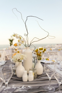 White and yellow centerpieces for destination wedding Los Cabos