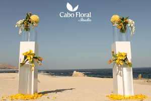 Wedding ceremony floral decor on the beach - Hilton Los Cabos