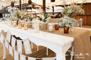 Unique Nikki beach Cabo bride and groom table decor and flowers