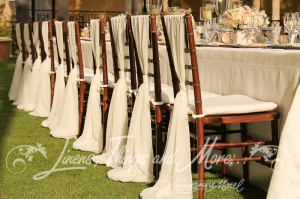 White chair ties Cabo wedding design by Suzanne Morel