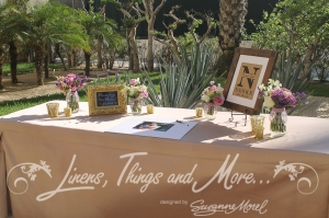 Romantic sand, gold and purple signing table decor by Linens Things and More Hyatt Los Cabos