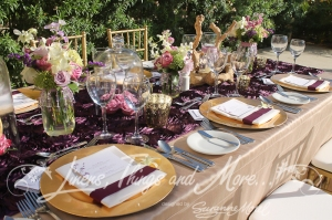 Rustic and elegant wedding decor purple and Champagne flowers Hyatt Los Cabos