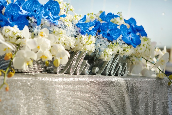 Silver sequins and blue orchids sweetheart table Dreams Los Cabos wedding